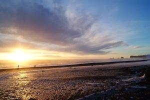 Sunset on the black sand beach, South Coast Tour